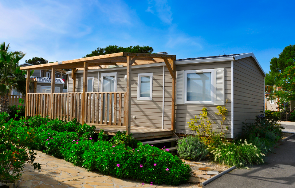 image of a mobile homes with a wooden front porch