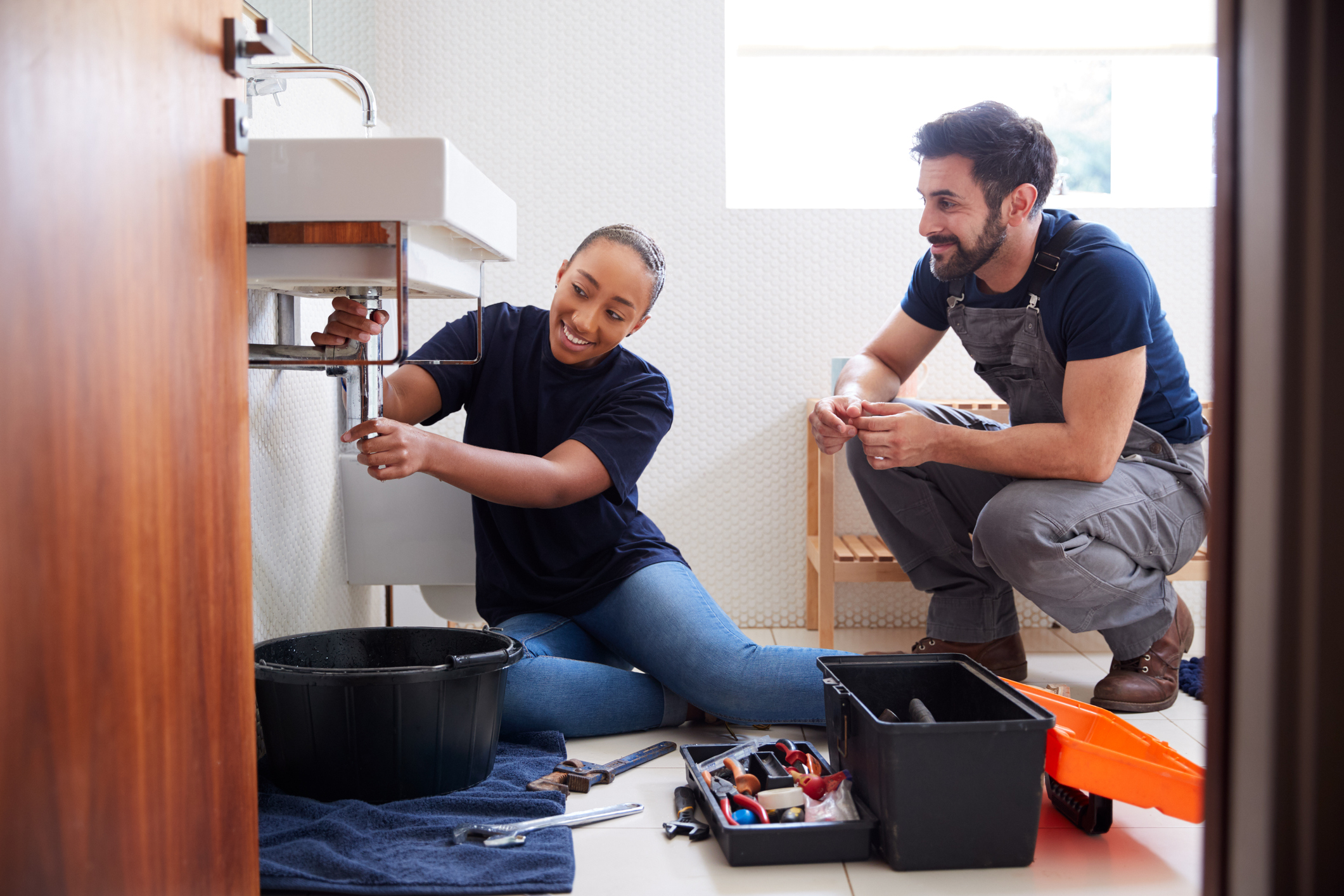 young man and woman doing rental property maintenance