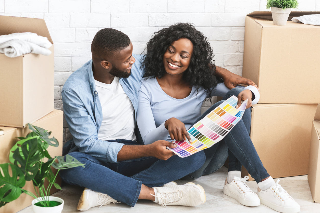 make your rental apartment cozy hero image: Just married couple choosing wall color for new apartment