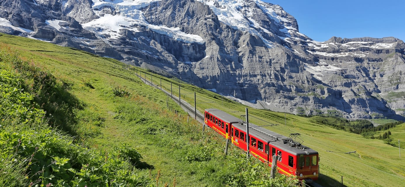 Electric red tourist train coming down from the Jungfraujoch station in Kleine Scheidegg, Bernese Oberland