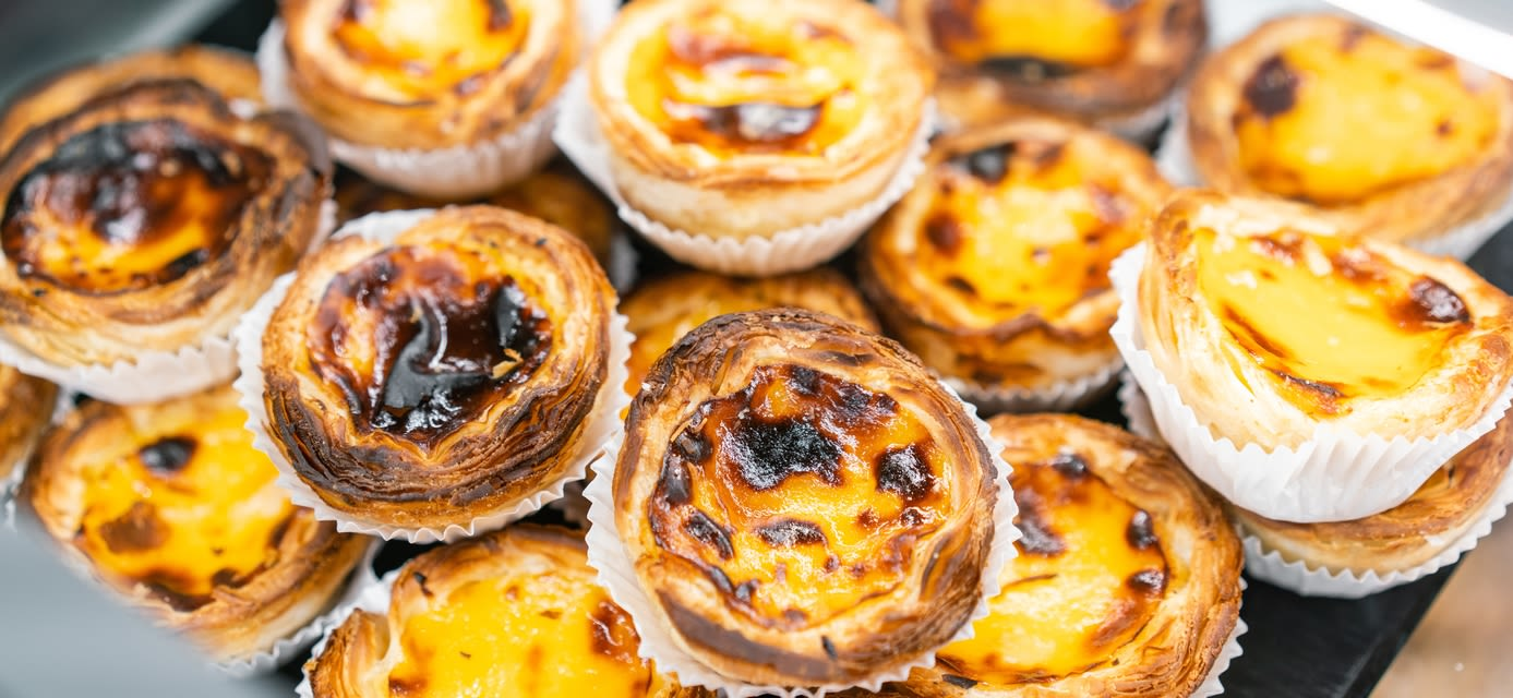 pasteis de nata, custard tarts. Cafe on the streets of Lisbon, Portugal