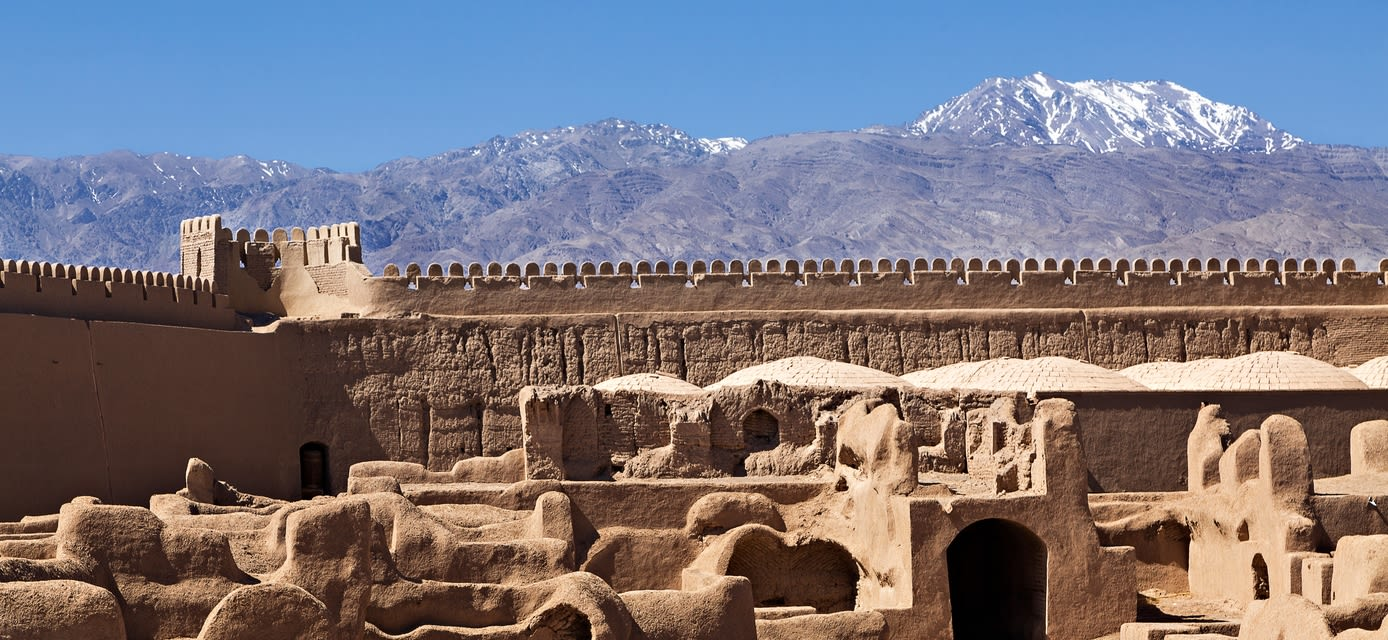 Ruins of adobe medieval town in Rayen, Iran