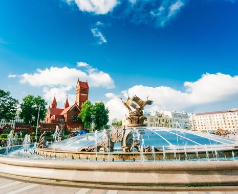 Fountain At Independence Square And Church Of Saints Simon And Helen (Red Church), Minsk, Belarus