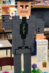 Students At Isaac E. Young Middle School Use Blocks To Create Statue