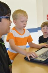 Fifth Graders At Todd Elementary Share Coding Skills With Kindergartners