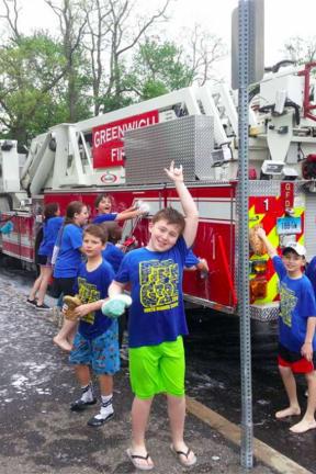 Fifth-Graders Dive In To Help Scrub Greenwich Fire Trucks