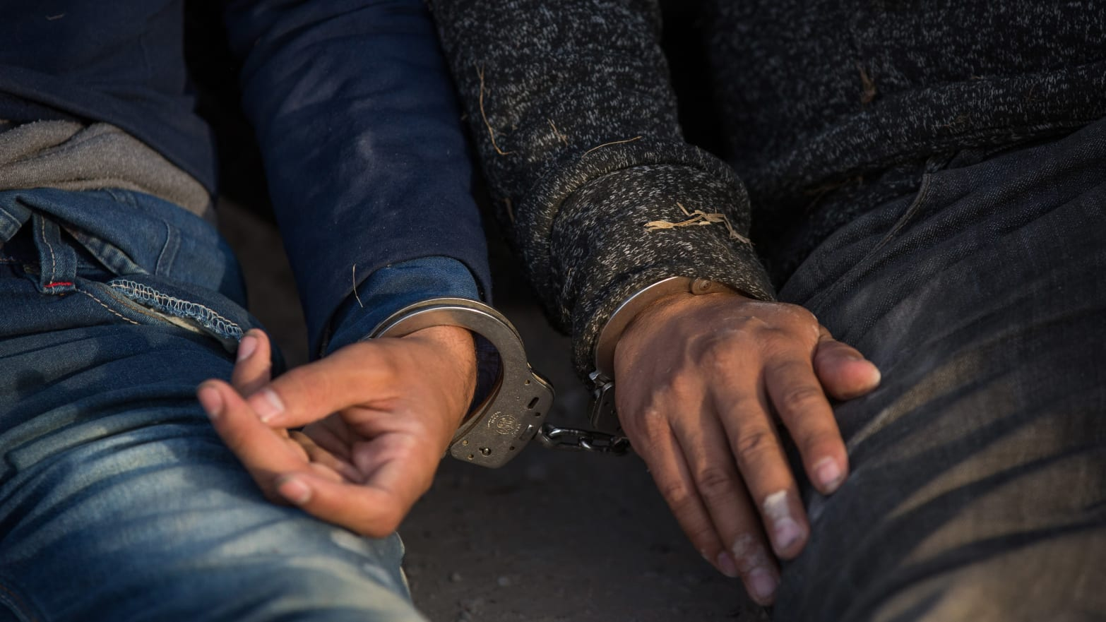 image of two men handcuffed to each other myth of criminal immigrant migrant caravan undocumented mexico central america