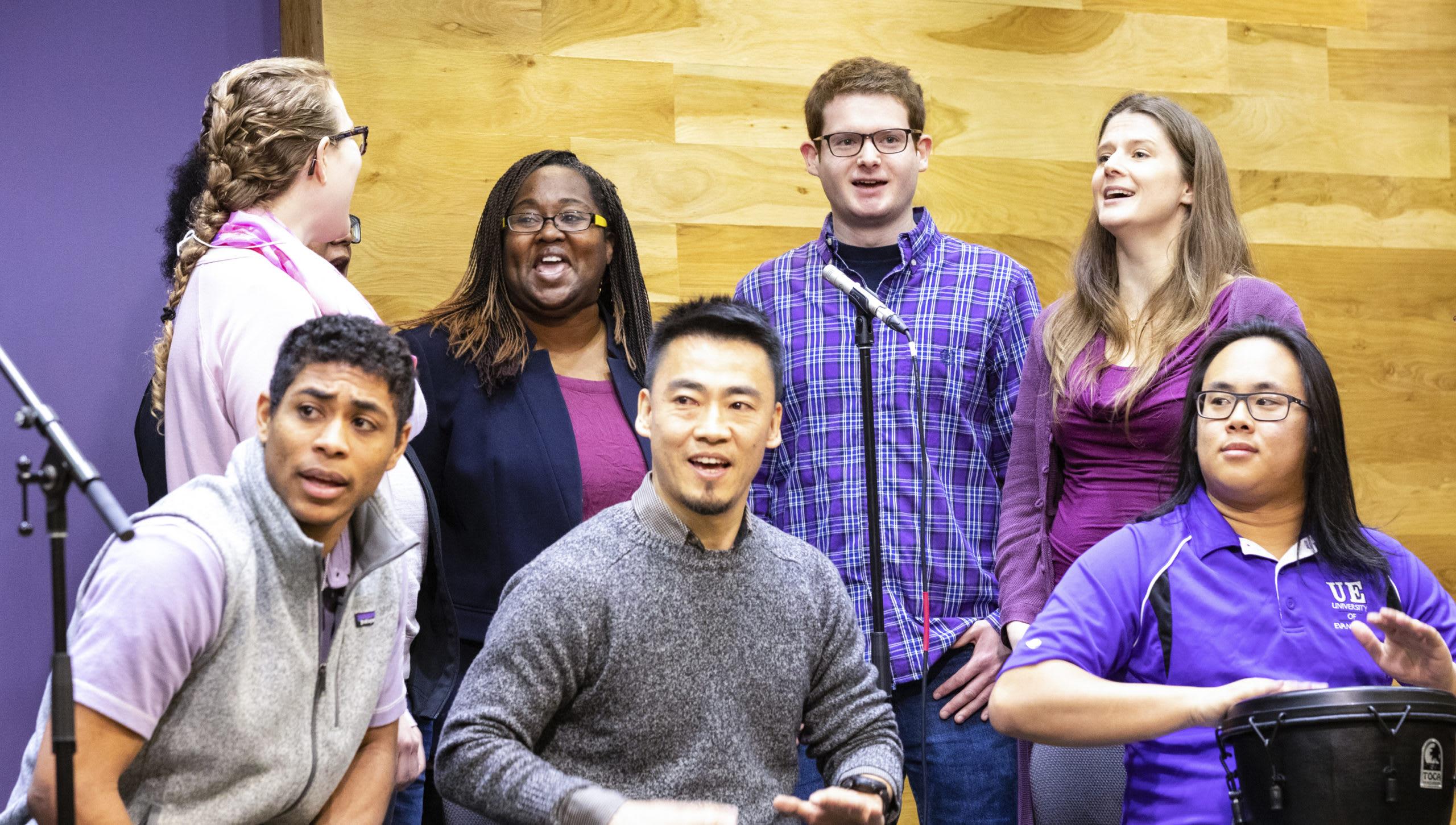 international students singing in chapel