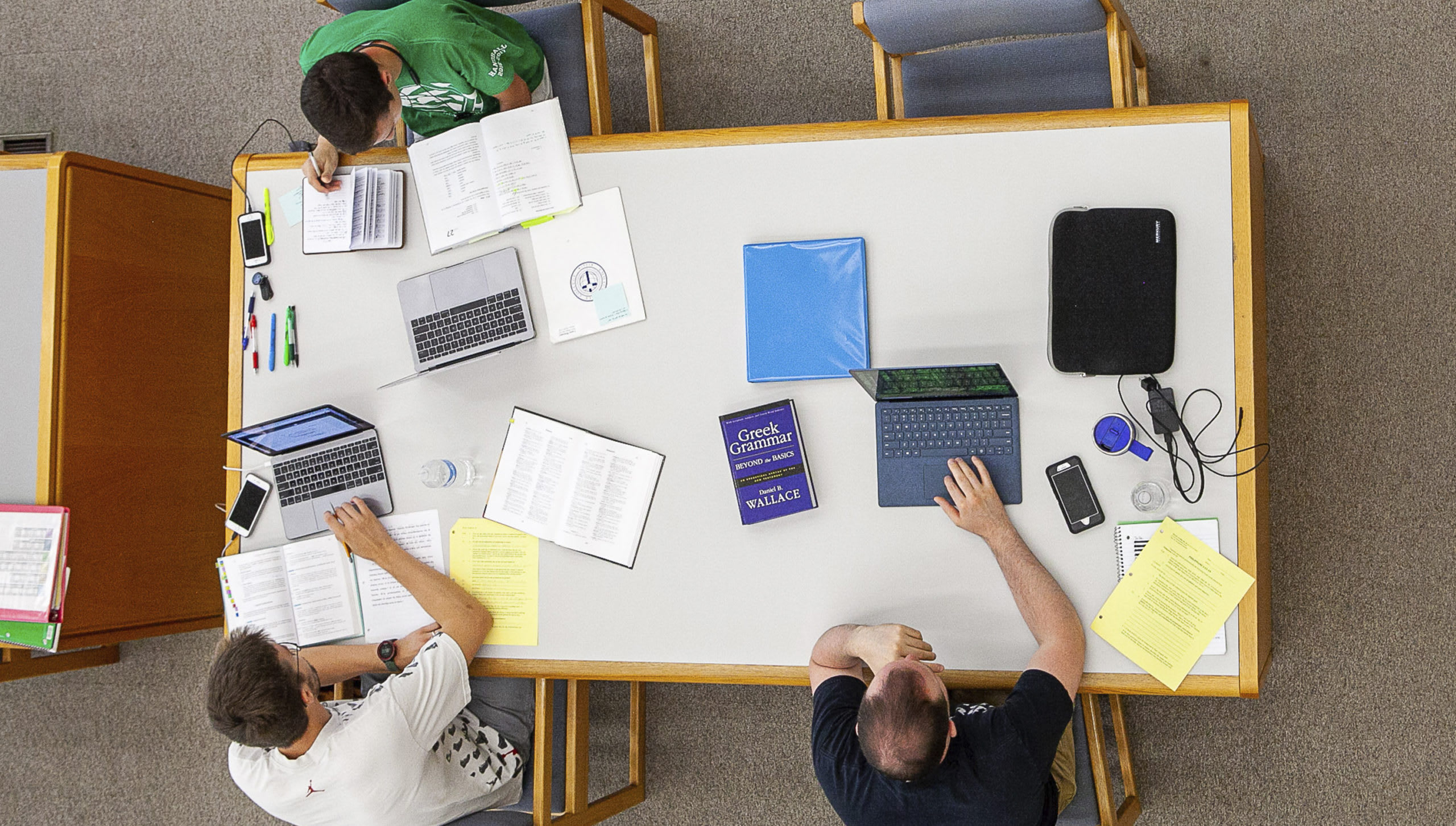 aerial view of three students in the library