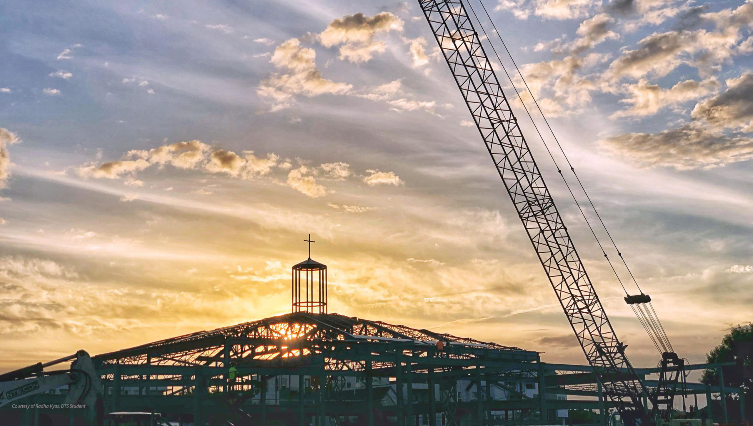 chapel under construction at sunset