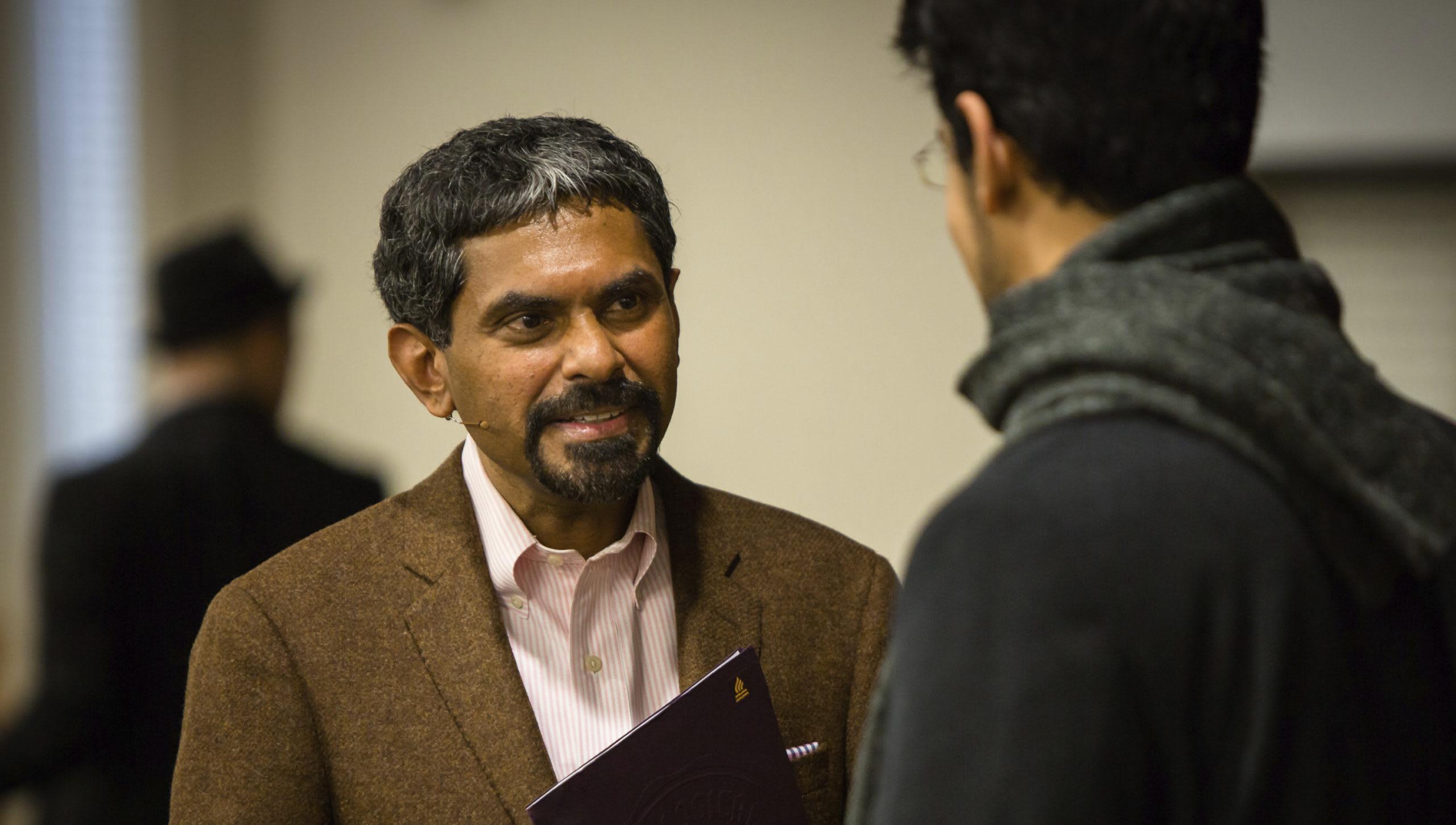Kuruvilla talking to a student