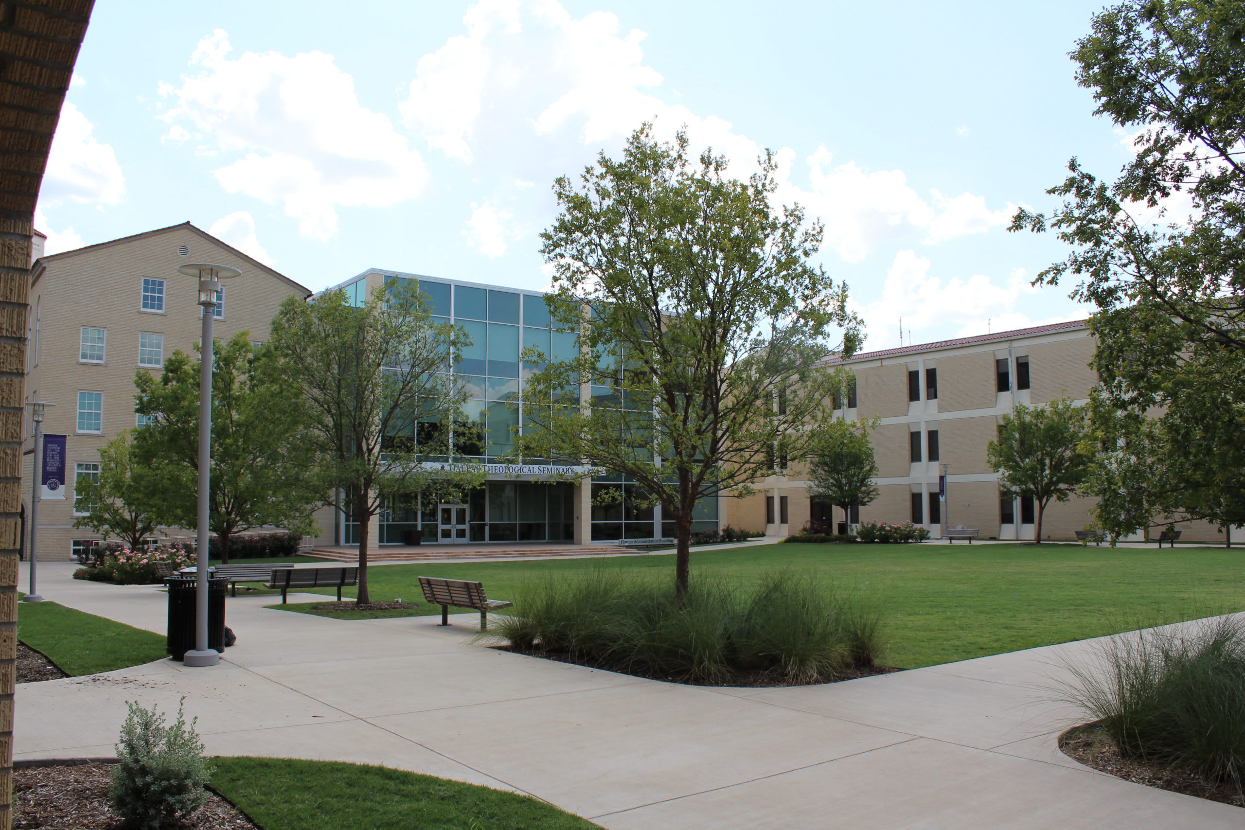 Lawn outside glass-walled entry and steps into Horner Administration Building