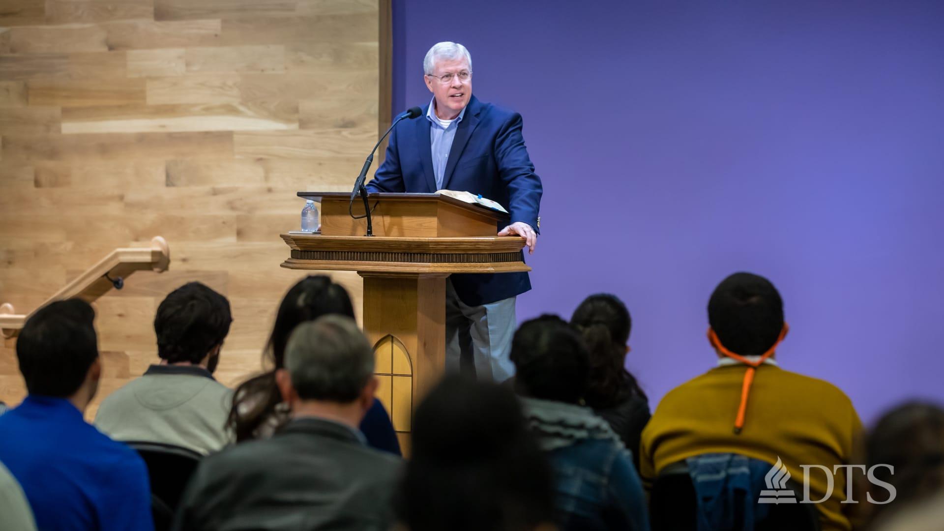 man standing at podium speaking at DTS Chapel