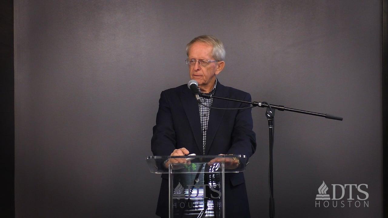 Dr. John Hannah standing at podium speaking at DTS Chapel
