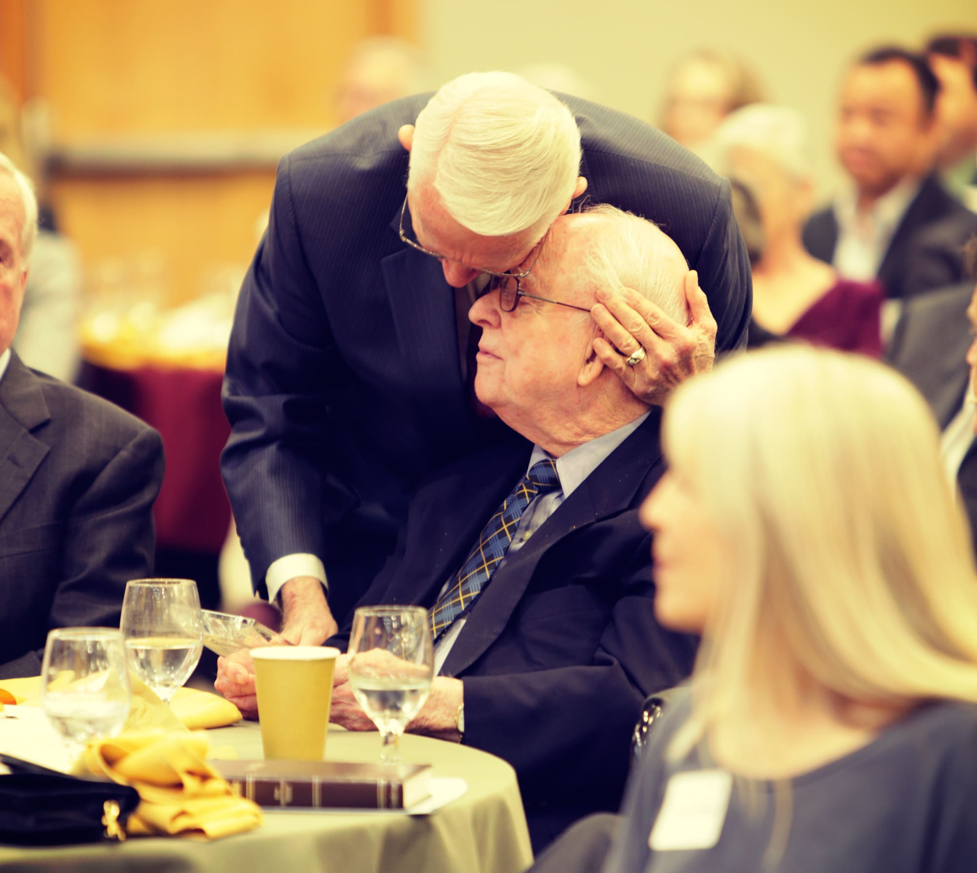 Chuck Swindoll hugging Dr. Campbell during recognition event