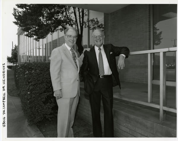 Dr. Campbell standing outside with Dr. Henricks