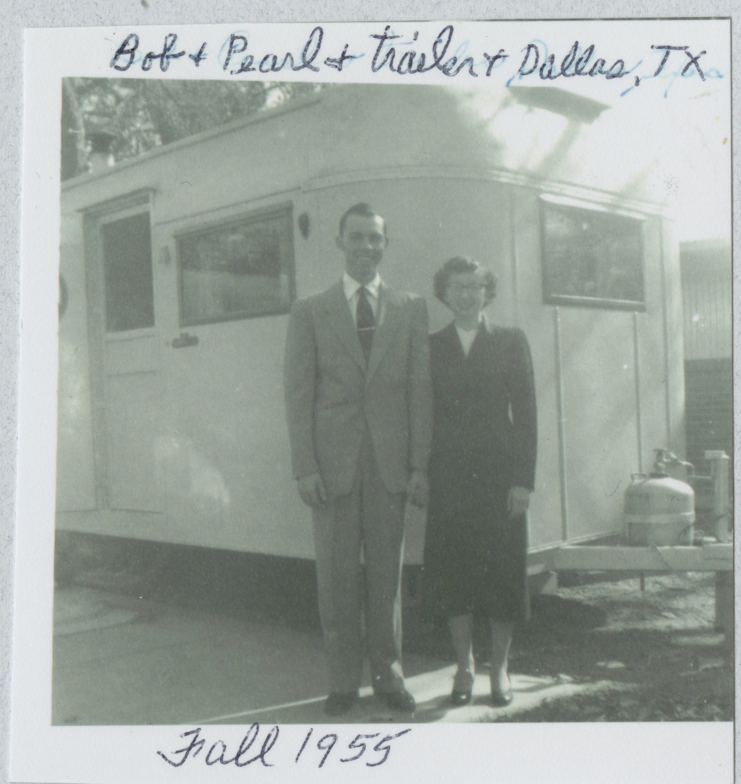 Dr. Lightner and his wife standing outside a mobile camper
