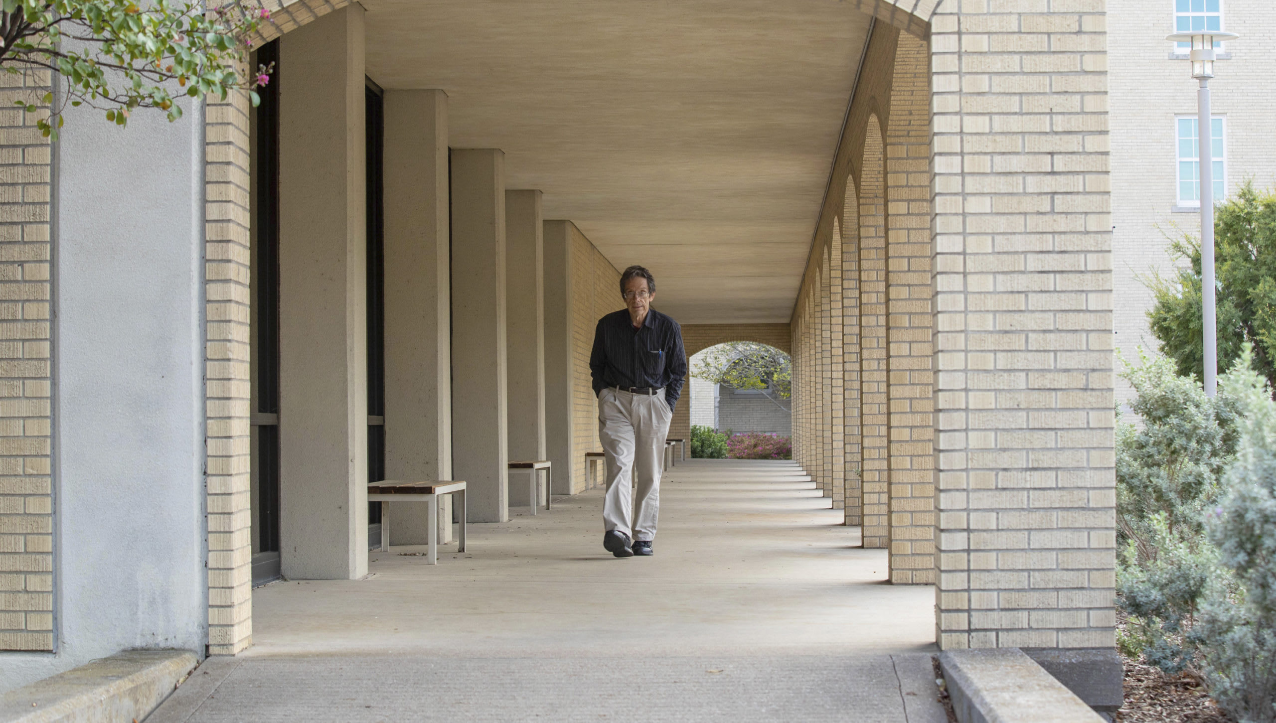 man walking in front of the library
