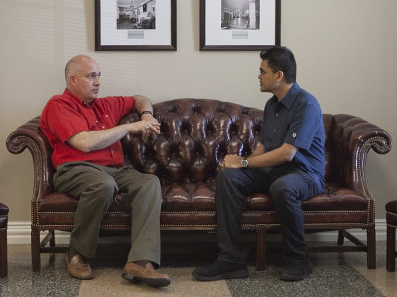 George Hillman and Mikel talking on a couch