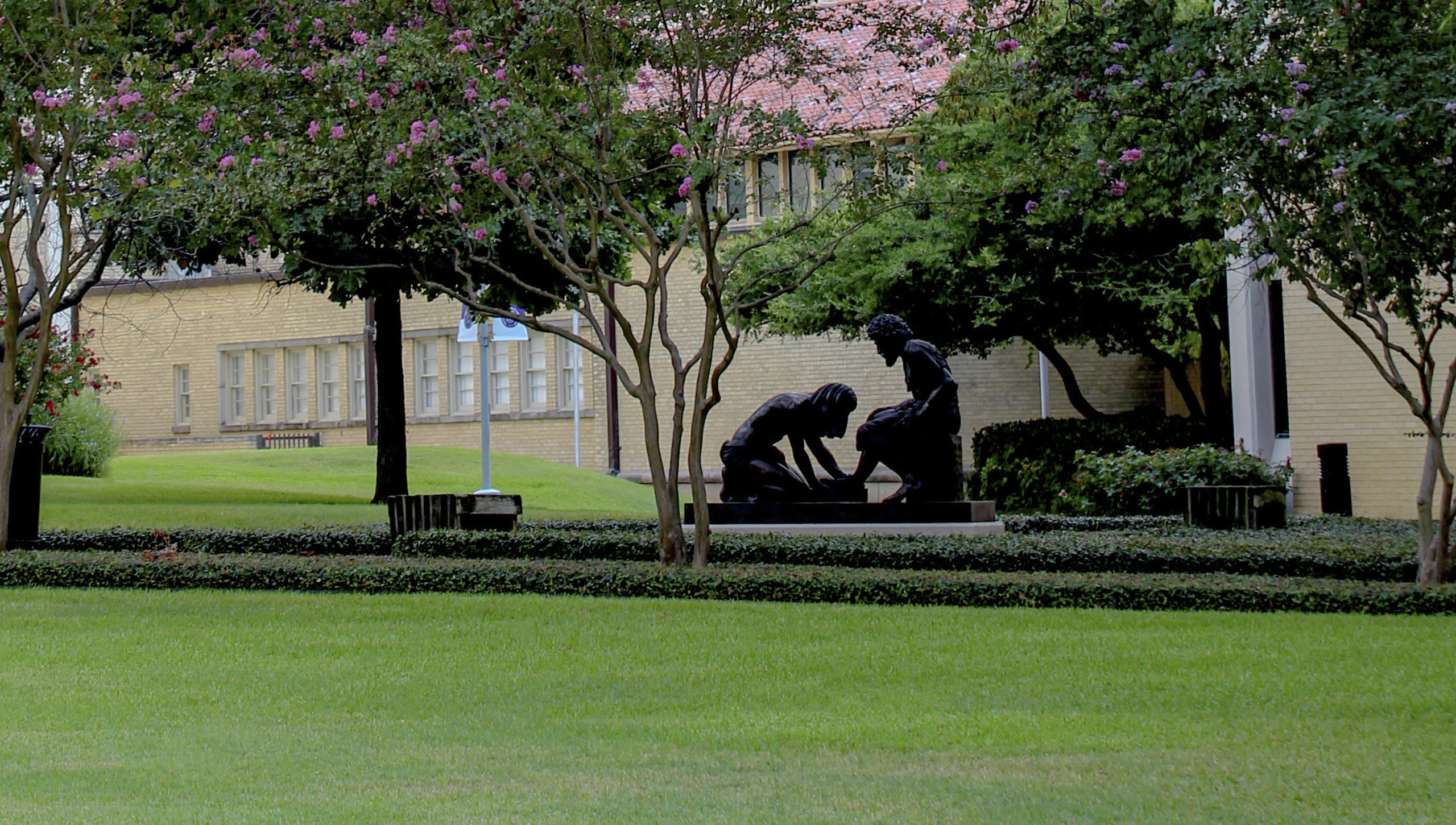 statue of Jesus washing disciples feet in front of Todd Building