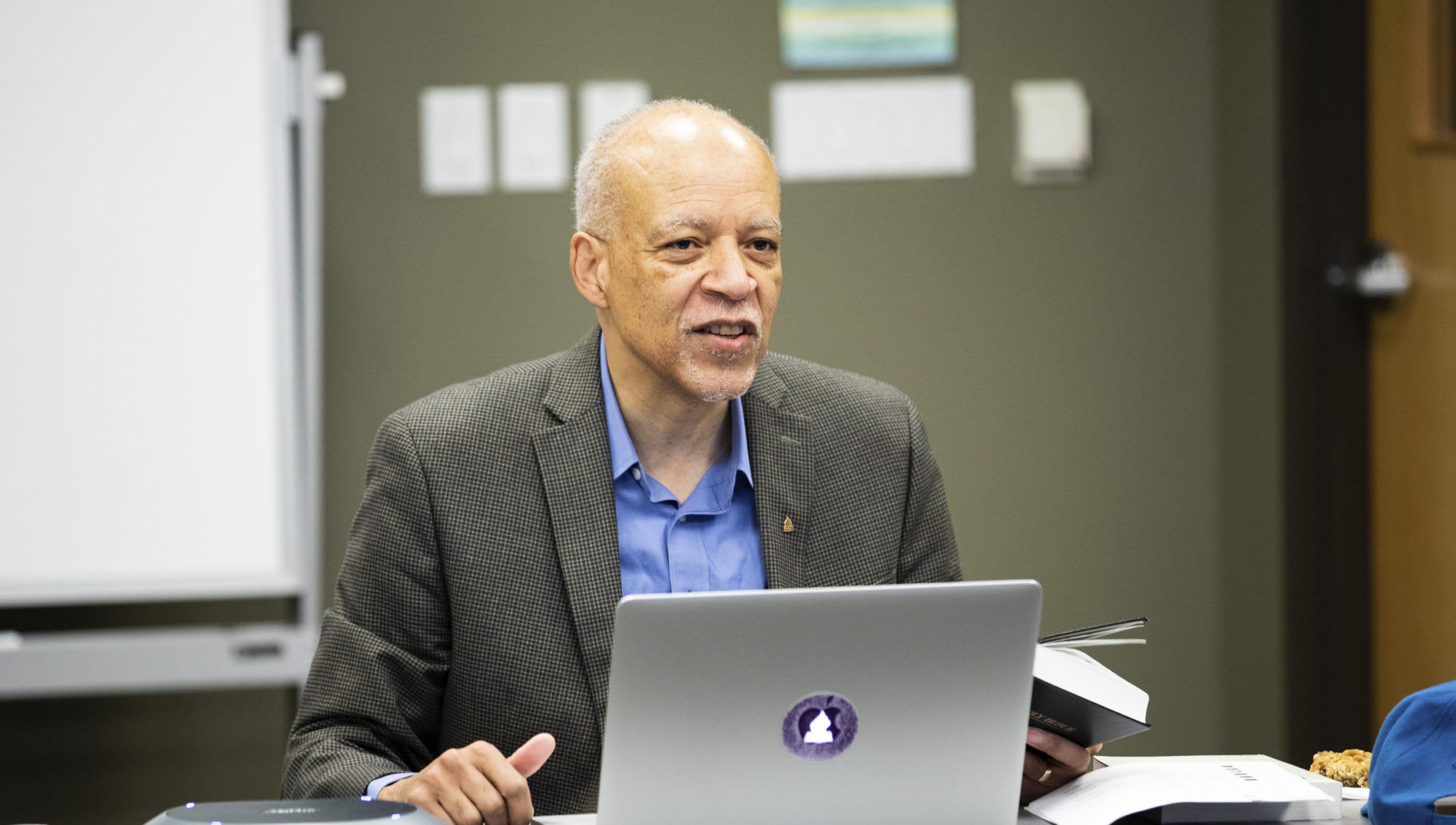 Dr. Orr teaching behind a laptop