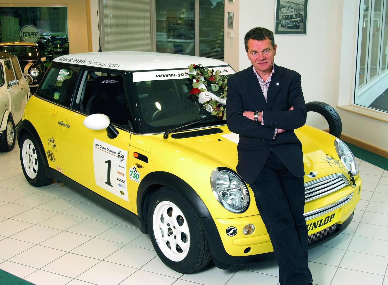 Michael Cooper sat on MINI Cooper Works R50 Yellow Car