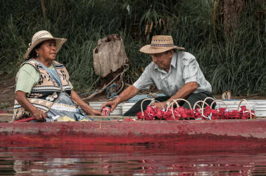 Couple sharing a coke at Xochimilco.
