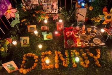 An altar at a grave for a seven-year-old boy on the night of November 1. Families who have lost children might light the altar on the night of October 31 and/or November 1 for the angelitos (little angels), who rush back home quicker than their adult counterparts, who arrive later on November 2.