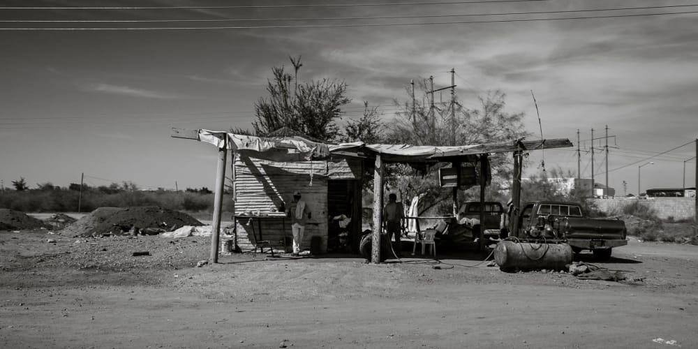 Men work at a shop along Highway 15 in Mexico.