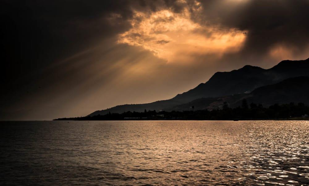 Sunbeams burst through the clouds west of Ajijic.