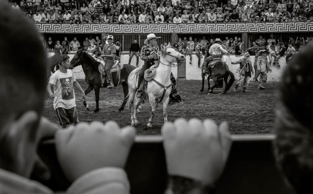 Kids watch the rodeo in the Ajijic bullring.
