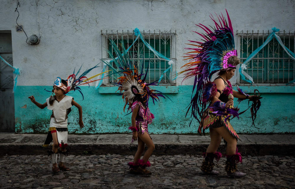 Aztec dancers during the Fiesta for Our Lady of the Rosary in Ajijic, Jalisco, Mexico.