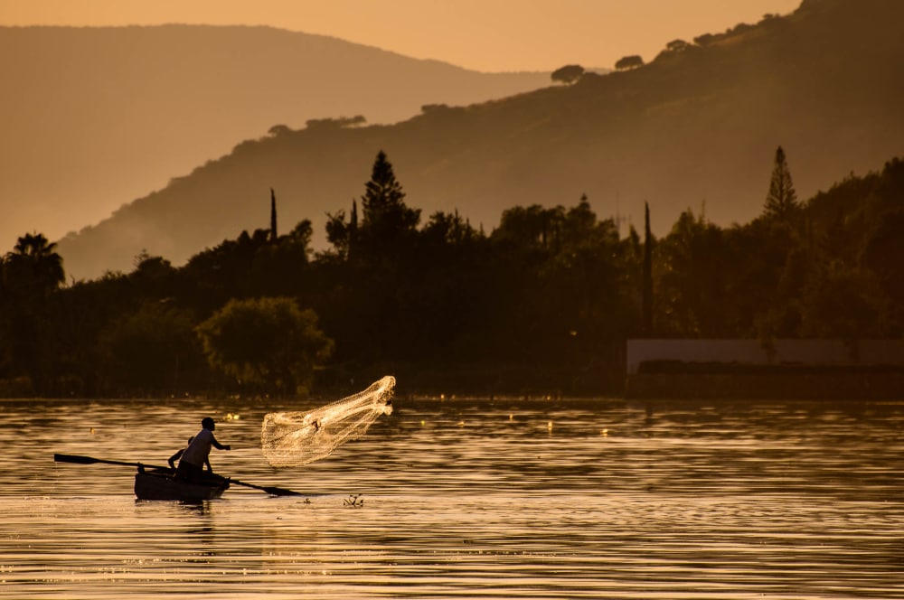 Men in a boat go net fishing at Lake Chapala, Mexico.