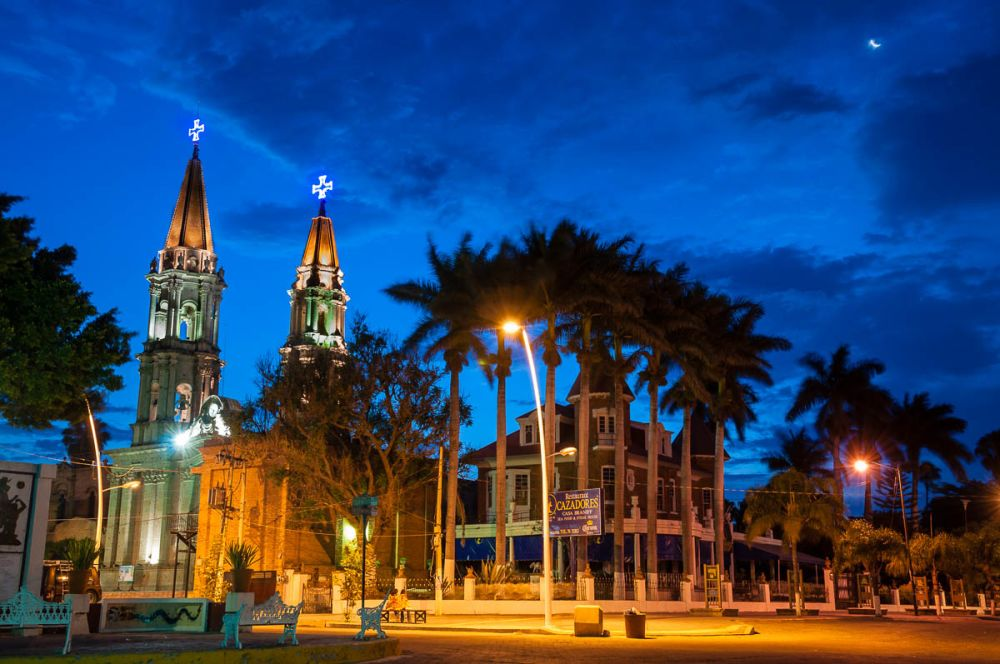 After 14 days, twilight breaks behind the twin spires of the church in Chapala, Jalisco, Mexico.