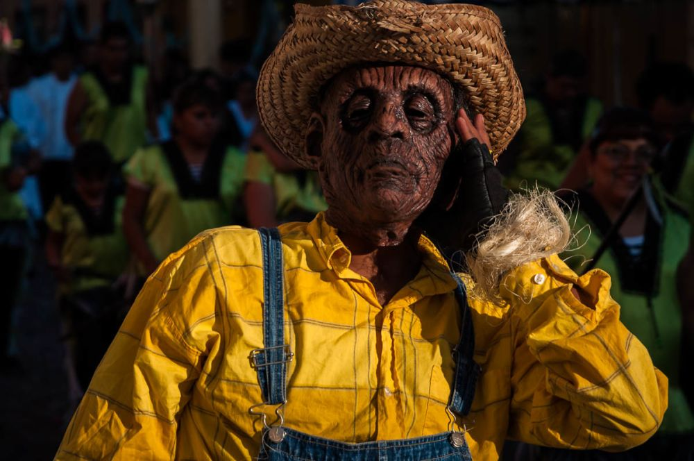 A masked participant of the parade for the Virgin of the Rosary on October 31, 2010. Ajijic, Jalisco, Mexico.