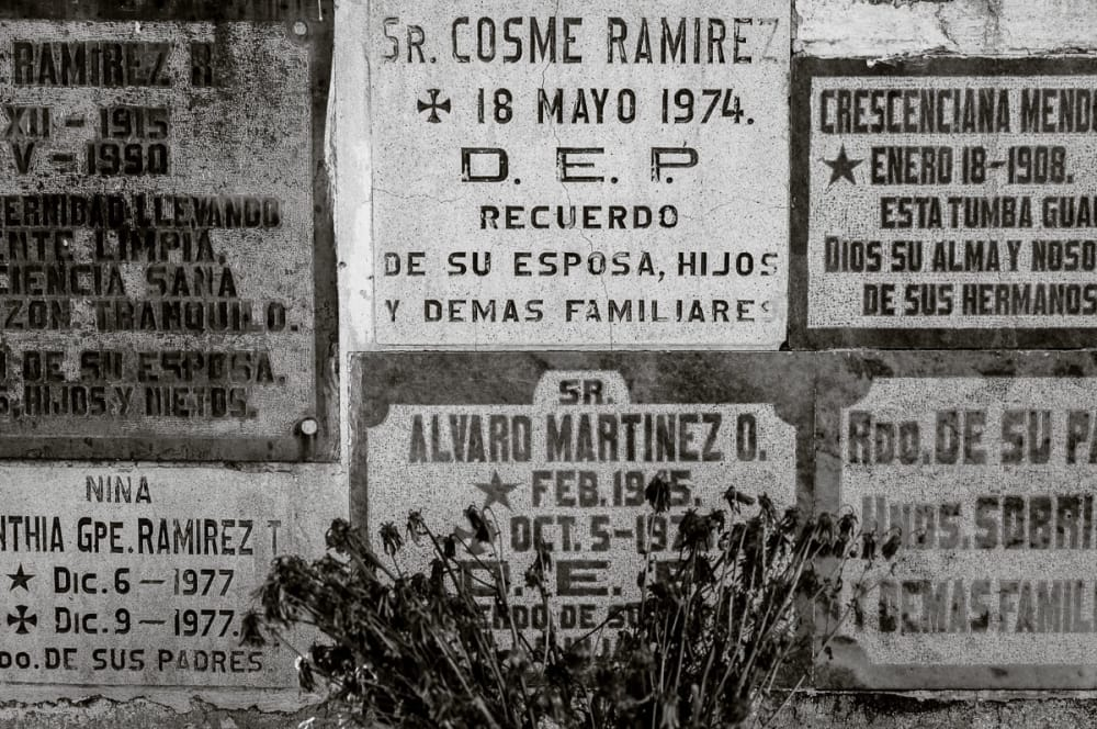 Names carved into headstones in the Chapala cemetery, Jalisco.