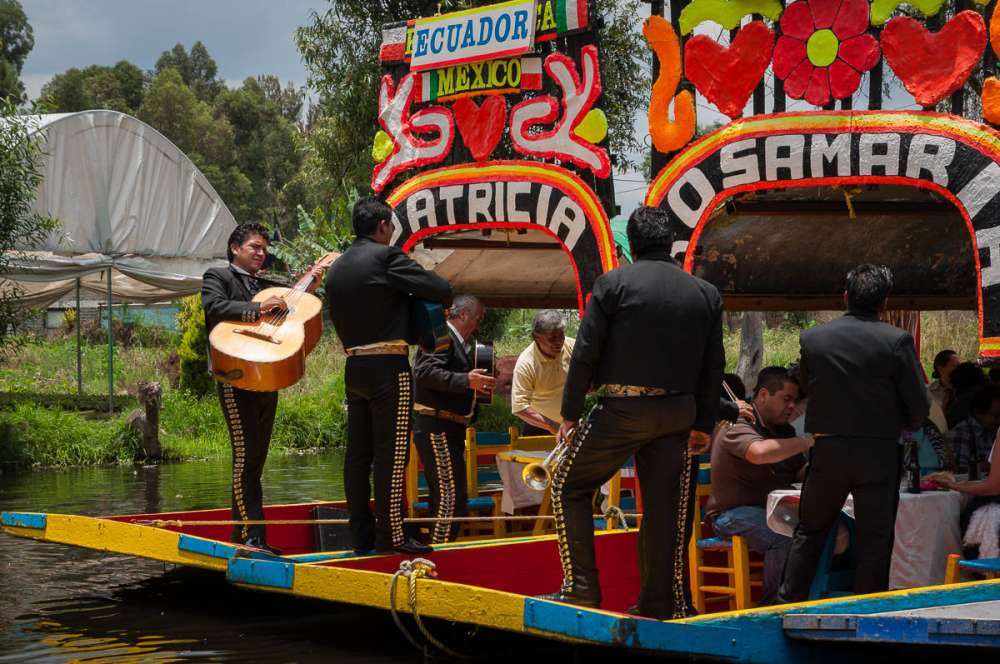 Musicians play for passengers aboard trajinera boats at Xochimilco in Mexico City.