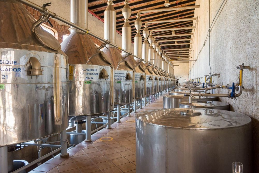 Distillation tanks distilling tequila at the Tequila Cazadores distillery in Arandas, Jalisco, Mexico.