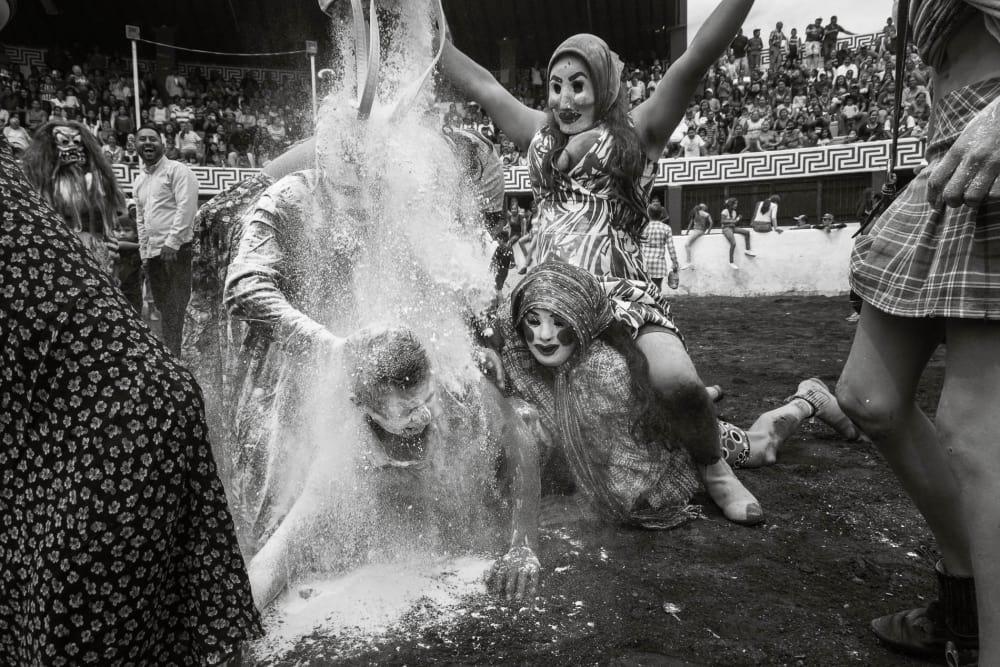 Zayacas tackle a man in Ajijic, Mexico, during Carnaval celebrations.