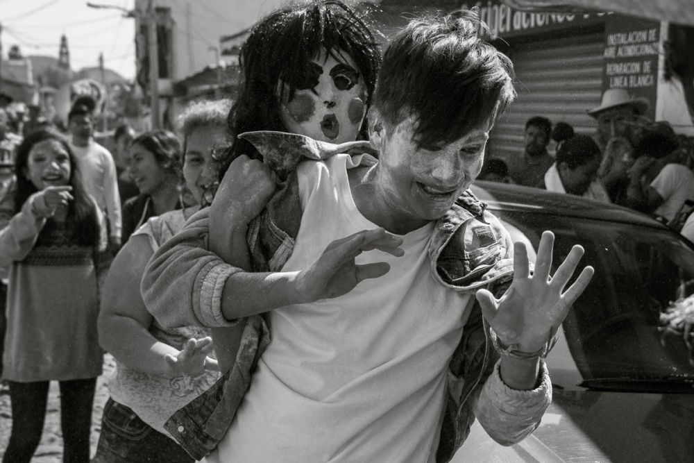 A zayaca grapples with a boy in Ajijic, Mexico
