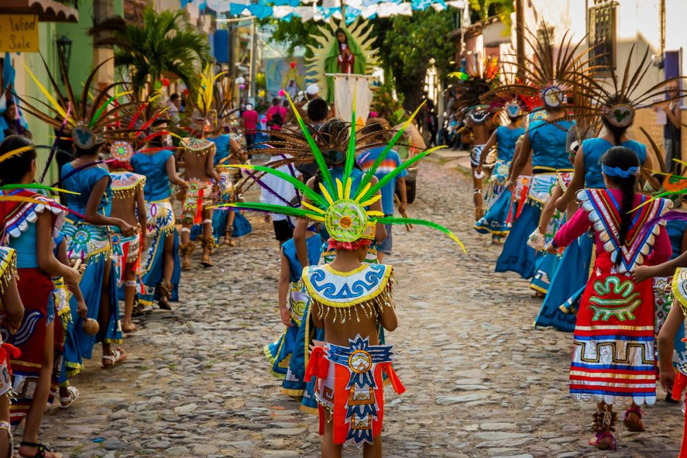 Aztec dancers are a big part of the procession, as they are during many of the town's holidays.