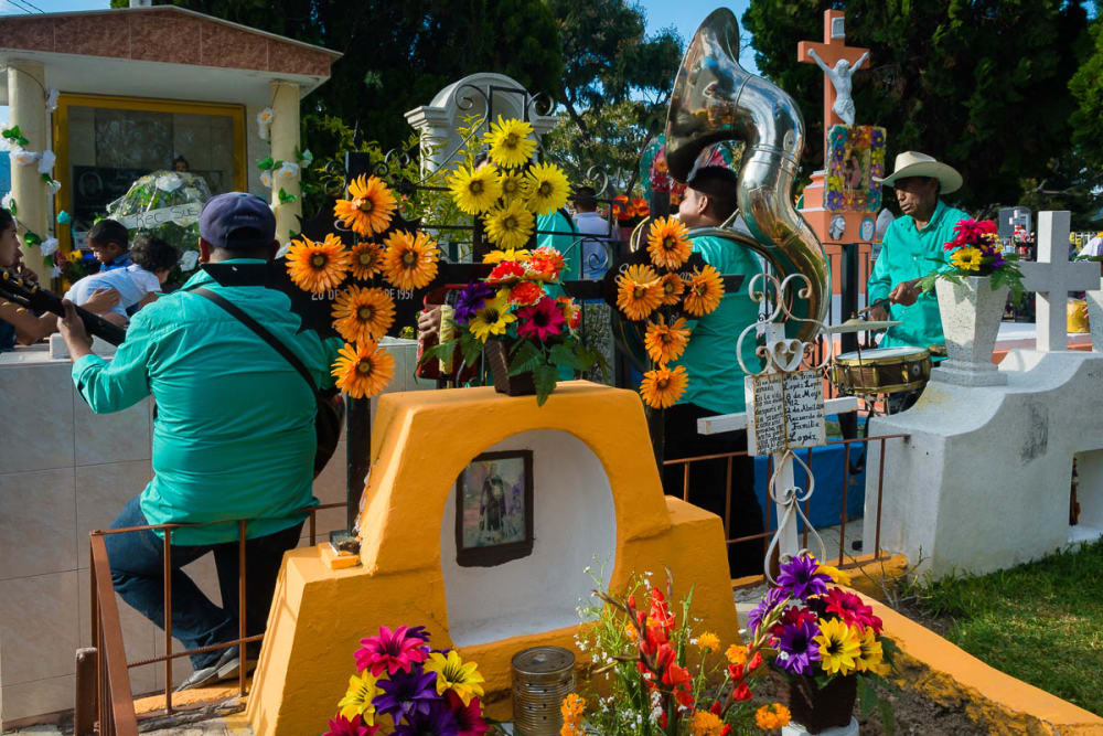 Musicians play in the Chapala, Jalisco, graveyard on the Day of the Dead.