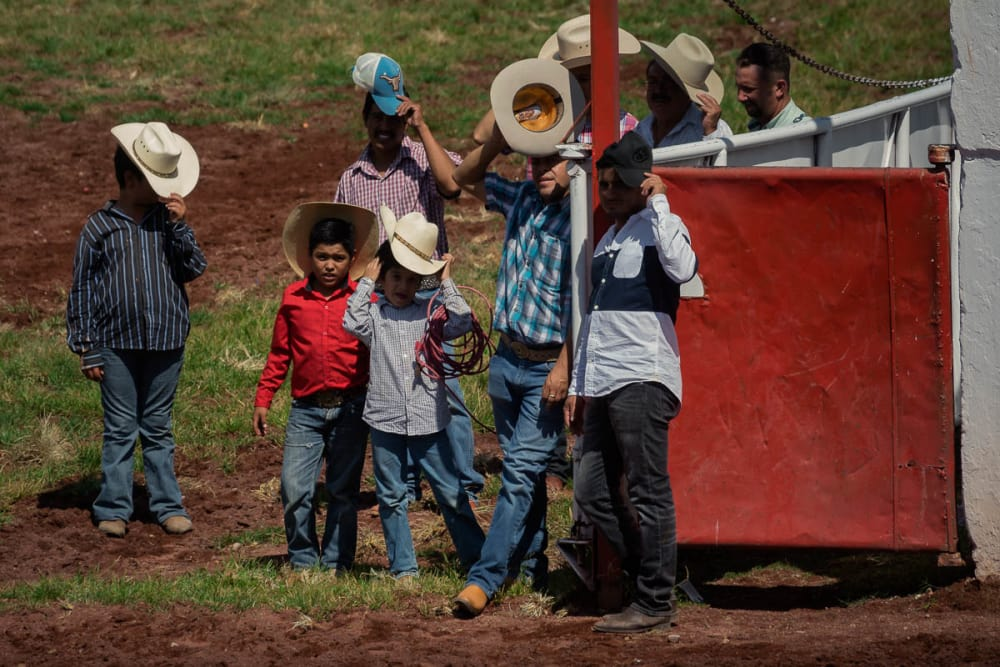 Kids watch the games and events going on during the Day of the Cowboy in Ajijic, Mexico.