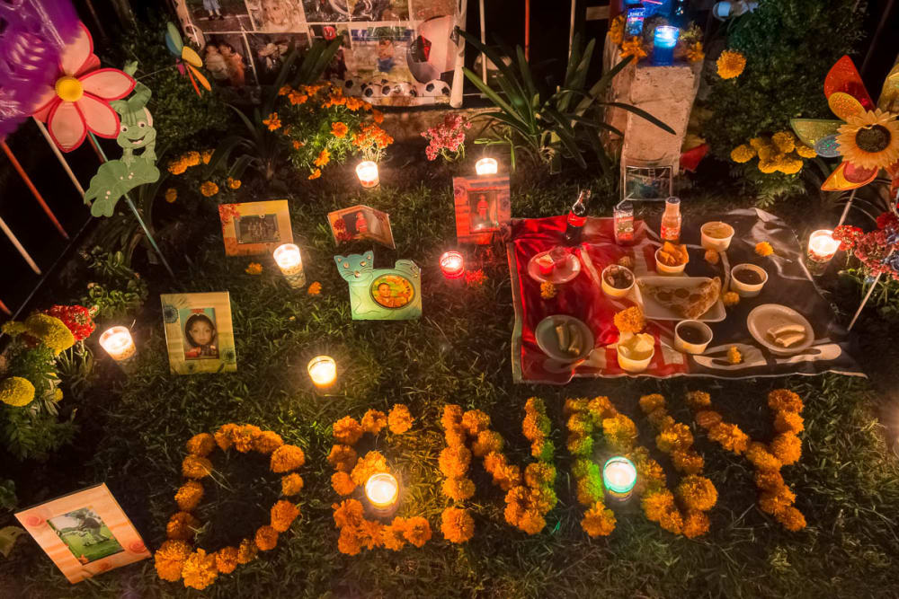 An altar at a grave for a seven-year-old boy on the night of November 1.