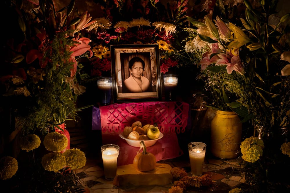A woman's portrait is illuminated by candlelight on November 1, 2015, in Ajijic, Jalisco, Mexico.