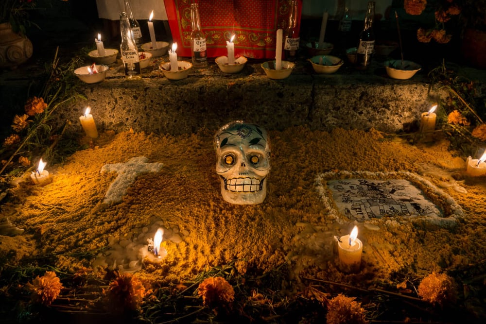 Emptied Corona bottles line the rear of an altar on Noche de Muertos 2015 in Chapala, Jalisco, Mexico.