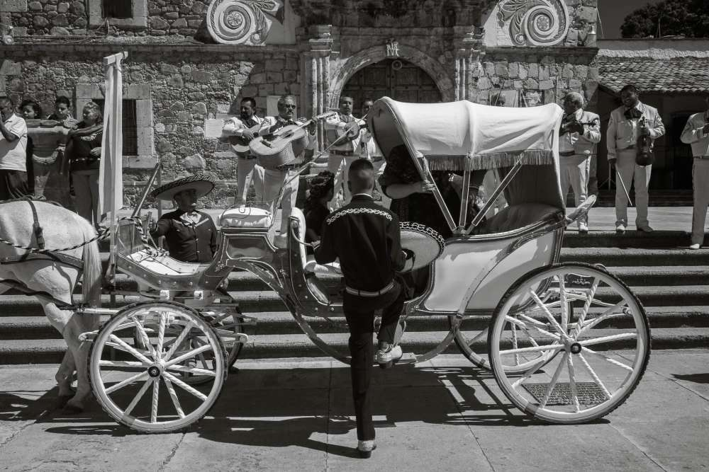 Wooden carriage in Ajijic during a procession for a quinceañera.
