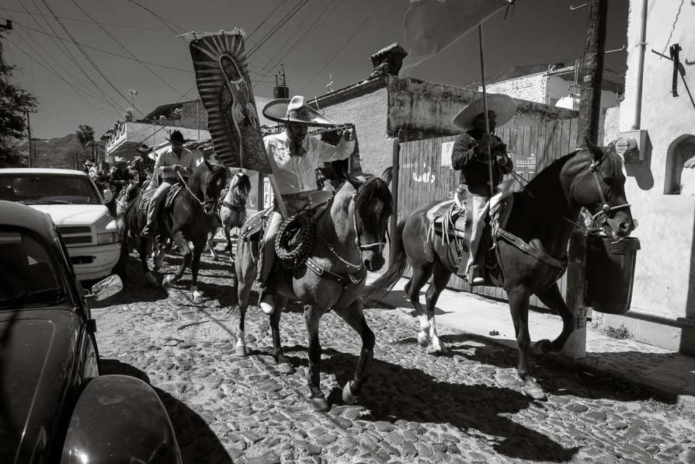 Cowboys during a procession for a quinceañera in Mexico.
