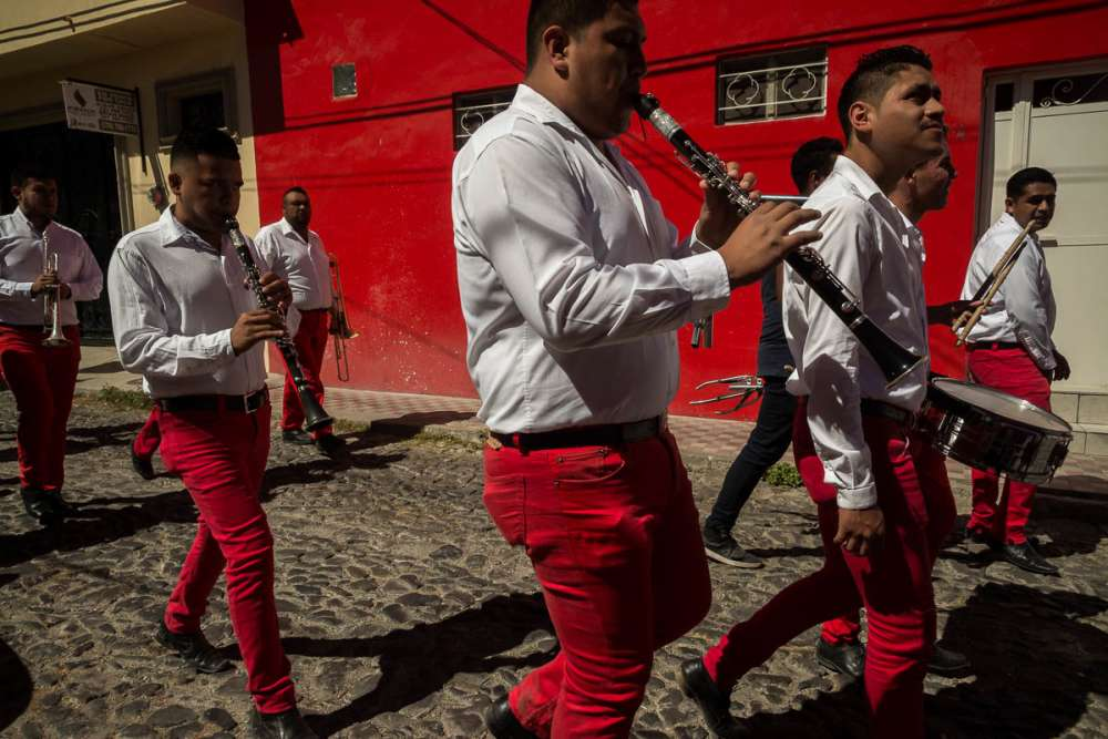 Banda with matching red pants play music in Jalisco.