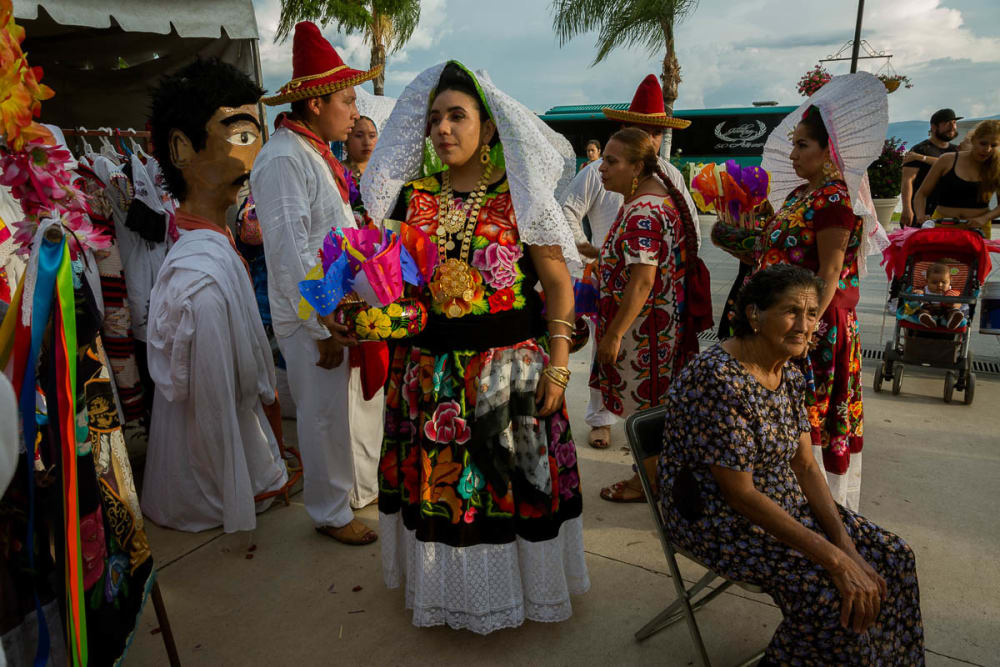 Dancers prepare for another dance during a performance of the guelaguetza in Chapala, Jalisco.